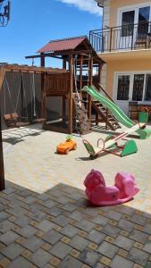 Children's play area at Гостевой дом Янтарный