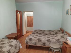 Кровать или кровати в номере Гостевой Дом Мишель