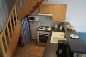 A kitchen or kitchenette at Apartment La Rochelle