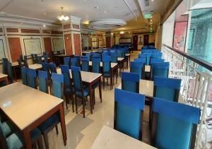 مطعم أو مكان آخر لتناول الطعام في فندق روتانا المسك