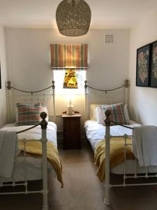 A bed or beds in a room at The Cottage