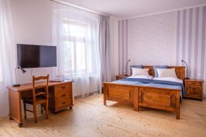 Posteľ alebo postele v izbe v ubytovaní Penzion U Madony