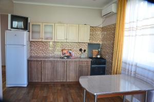A kitchen or kitchenette at Гостевой дом Абрикосовый