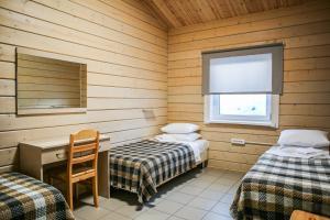 """Кровать или кровати в номере Гостевые дома """"Баренц"""""""