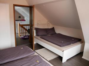 Ein Bett oder Betten in einem Zimmer der Unterkunft Odas Feriendomizil