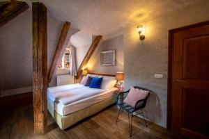 A bed or beds in a room at Miss Sophie's Charles Bridge