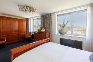 Ein Bett oder Betten in einem Zimmer der Unterkunft Hotel La Rosa Amsterdam Beach