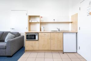 A kitchen or kitchenette at Hawkesbury Race Club Motel