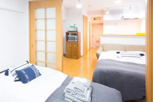 A bed or beds in a room at E-address Shibuya 26