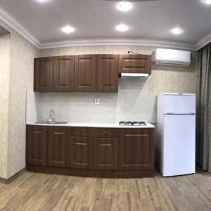 A kitchen or kitchenette at Гостевой дом ,,Радуга""