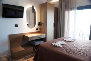 Ένα ή περισσότερα κρεβάτια σε δωμάτιο στο Golden Sun