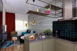 A kitchen or kitchenette at Citadines Sloterdijk Station Amsterdam