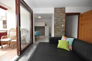 A bed or beds in a room at LUXURY APARTMENT KALA 2