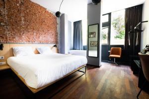 Cama ou camas em um quarto em The Arcade Hotel Amsterdam