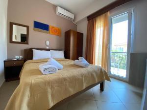 Ένα ή περισσότερα κρεβάτια σε δωμάτιο στο Maritsa's Rooms