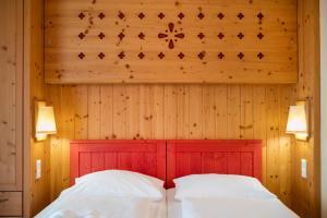 Ein Bett oder Betten in einem Zimmer der Unterkunft JUFA Hotel Tieschen - Bio Landerlebnis