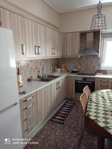 A kitchen or kitchenette at Nansy's Cosy Place