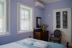 Uma cama ou camas num quarto em Porto.arte guest apartments