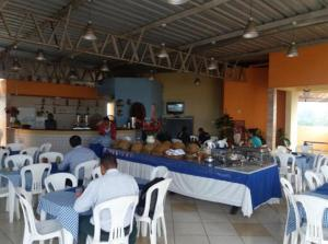 A restaurant or other place to eat at Hotel Santa Maria Madalena