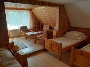 Łóżko lub łóżka w pokoju w obiekcie Dom Wypoczynkowy Aga