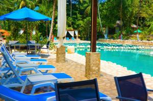 The swimming pool at or near Hotel Chan-Kah Resort Village Convention Center & Maya Spa