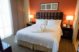 A bed or beds in a room at Embassy Suites Ontario - Airport