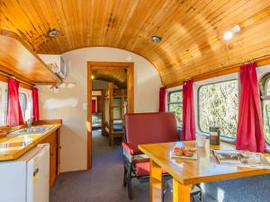 A restaurant or other place to eat at Ohakune Train Stay - Carriage B