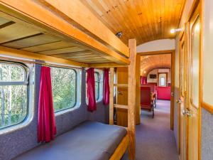 A bunk bed or bunk beds in a room at Ohakune Train Stay - Carriage B
