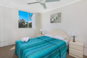 A bed or beds in a room at The Bay Apartments Coolangatta