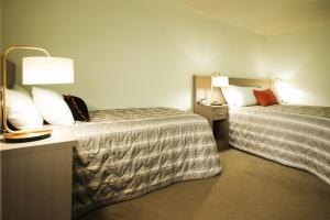 A bed or beds in a room at Loxton Community Hotel Motel