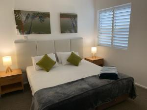 A bed or beds in a room at Portsea29