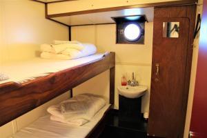 Een stapelbed of stapelbedden in een kamer bij AmicitiA