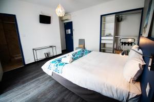 Un ou plusieurs lits dans un hébergement de l'établissement Hôtel Bel Azur