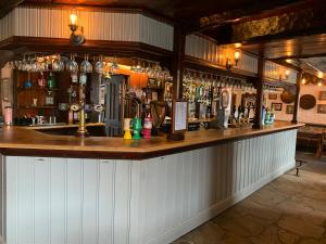 The lounge or bar area at The Hermitage Inn