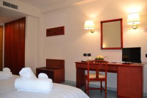Letto o letti in una camera di Tafuri Hotel