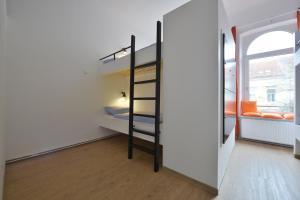 Ein Etagenbett oder Etagenbetten in einem Zimmer der Unterkunft Townside Hostel Bremen
