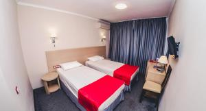 A bed or beds in a room at Anapa Okean Health Resort