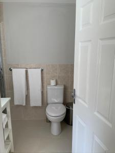 A bathroom at Vauxhall Apartments