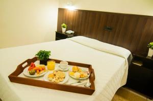Кровать или кровати в номере Mediterrâneo Park Hotel