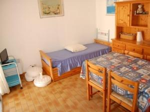 A bed or beds in a room at Rental Apartment Les Zodiaques 2