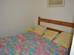 A bed or beds in a room at Rental Apartment Les Terrasses Du Port