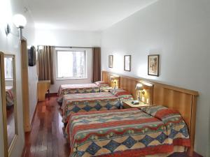 Cama ou camas em um quarto em Ritz Plaza Hotel