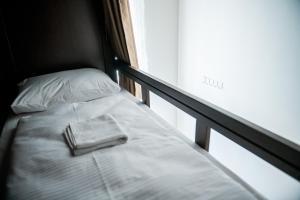 Postel nebo postele na pokoji v ubytování Vienna Boutique Hostel
