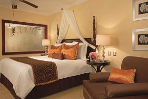 A bed or beds in a room at Dreams Palm Beach Punta Cana