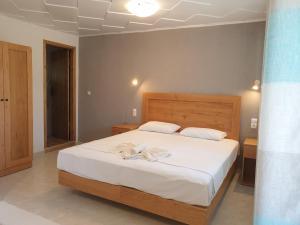 Ένα ή περισσότερα κρεβάτια σε δωμάτιο στο Διαμερίσματα Ξενοφών