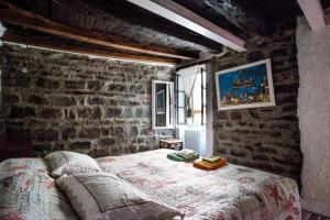 Letto o letti in una camera di Casa Filomena