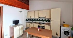 Kuchyň nebo kuchyňský kout v ubytování Appartamenti Marina Maria