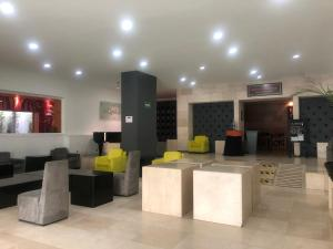 The lobby or reception area at We Hotel Aeropuerto