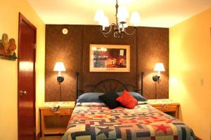A bed or beds in a room at Northland Lodge