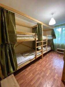 A bunk bed or bunk beds in a room at Лайм